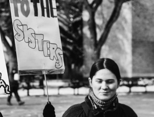 MAMANUSHKA.com || To Be A Woman || International Women's Day Rally || Edmonton || Image By Abdul Malik || Power To The Sisters || Women's Protest Sign