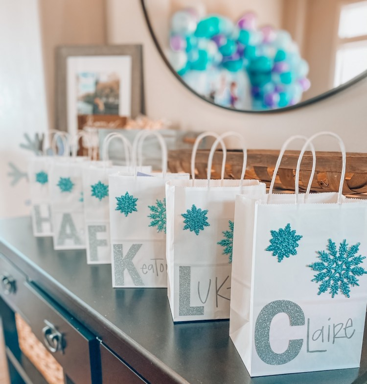 I searched everywhere for the perfect party favor bags, but couldn't find anything that wasn't outrageously expensive! So... I decided to make ours instead. They turned out super cute and the kiddos LOVED the gifts inside