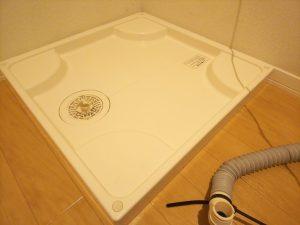 洗濯機の排水口と防水バンを掃除した後の写真