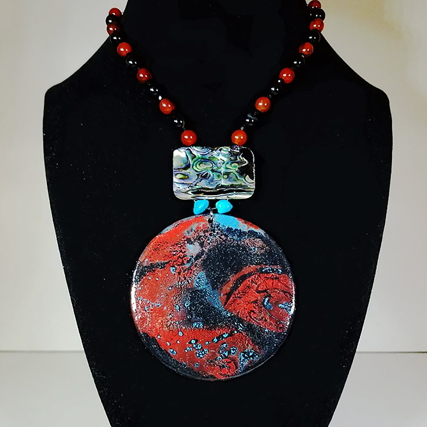 "Leslie Hardie, Painted Necklace with Gemstones, Wood, acrylic, turquoise, abalone, onyx, and carnelian, 19"" length, $250"