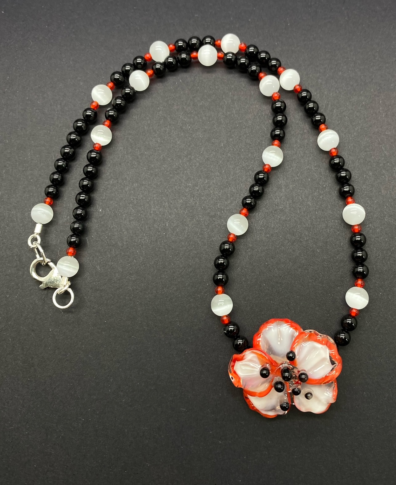 "Mindy Ackerman, Handmade Glass Flower, Black Onyx, White Fiberoptic Glass, Sterling Silver Clasp, 17"", $75"