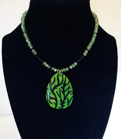 """Leslie Hardie, Onyx and crystal necklace with painted wood pendant 18"""" - 20"""", $150"""