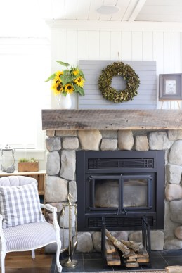 farmhouse-mantel-decor-sunflowers-and-a-boxwood-wreath-4