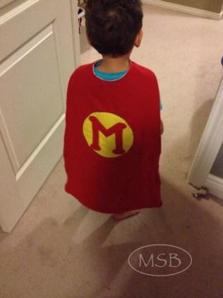 M modelling his cape