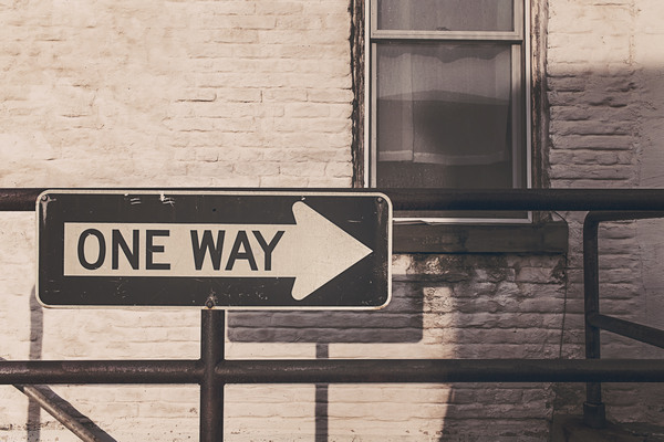 One way sign to compassion
