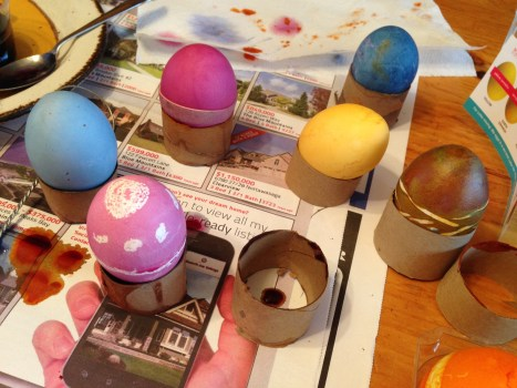 cut a paper towel roll for egg drying stands; don't remove elastics until colour is dry.