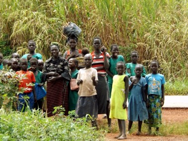 Onlooking villagers in Hoima, Uganda