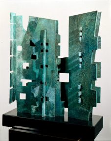 Abstract sculpture in patinated bronze with a black marble base