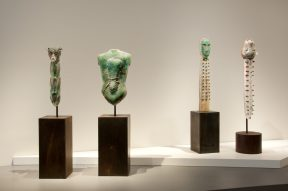 Installation shot of four sculptures at a museum