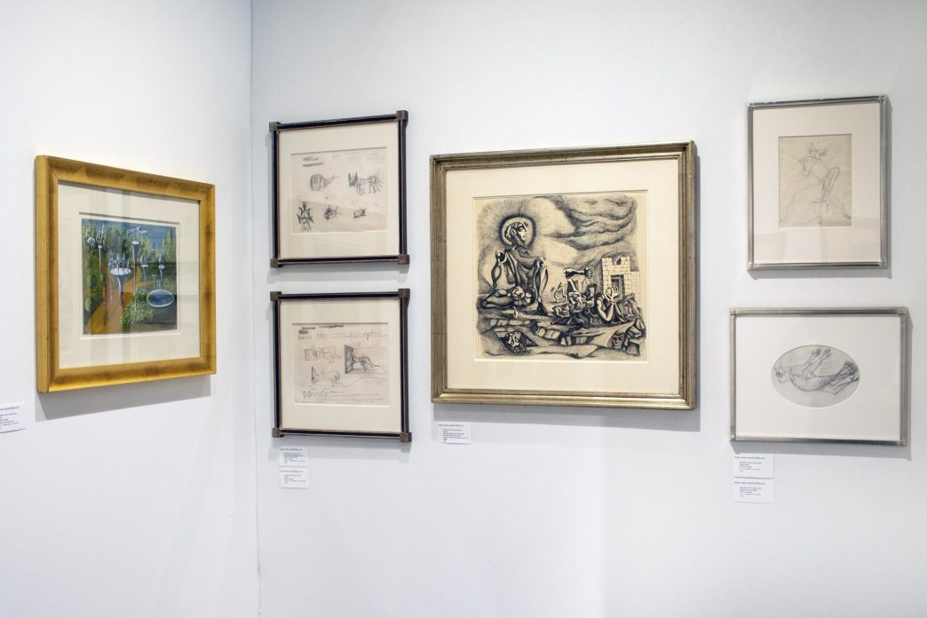 Installation shot of a booth at an art fair with drawings