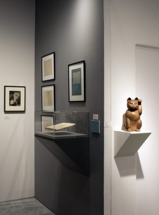 Installation shot of the gallery's exhibit Reigning Cats and Dogs at an art fair