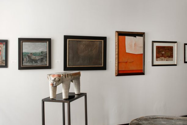 Installation shot of paintings and sculptures in the front gallery