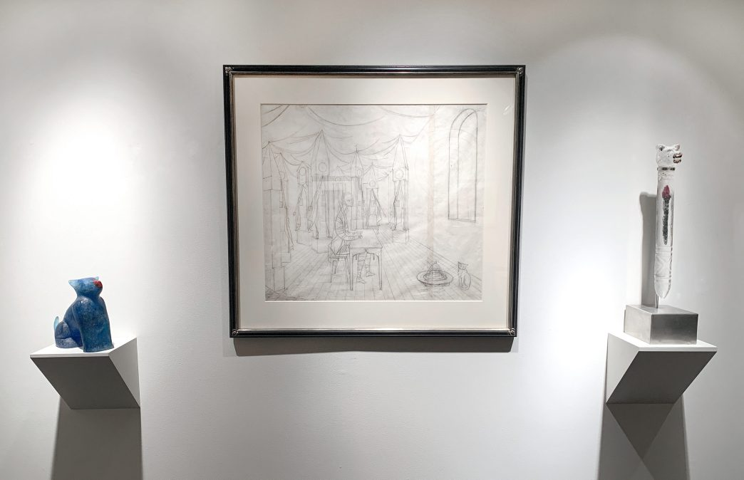 Installation shot of a large drawing in between two glass sculptures