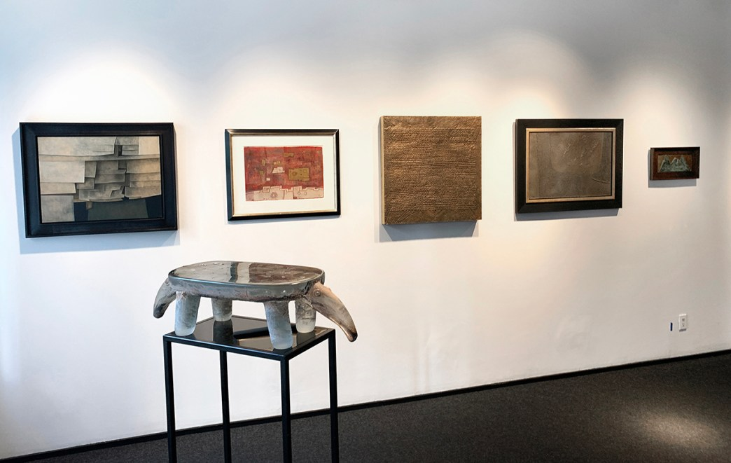 Installation shot of the front gallery with five works on the wall and a large glass sculpture