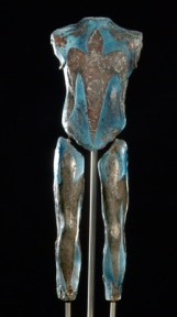 Blue glass sculpture of a torso and legs with grey birds silhouetted on the front