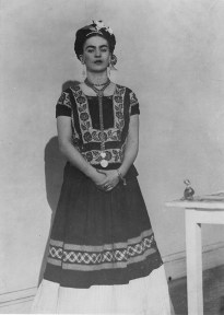 A black and white photograph of Frida Kahlo.