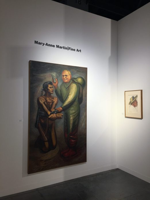 Installation shot of two paintings in a booth at an art fair