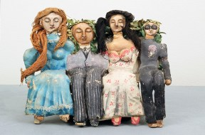 A papier mache sculpture of four seated figures