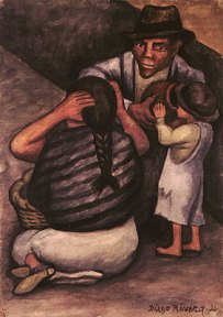 A man, and woman, and a child seated on the ground.