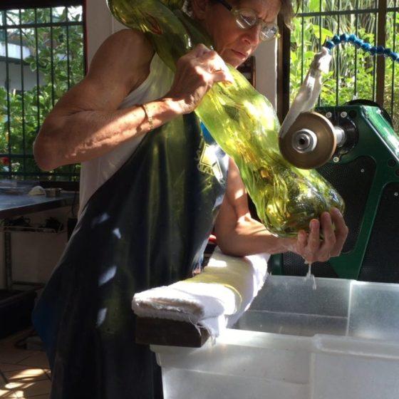 Photograph of the artist Isabel De Obaldía creating a blown glass sculpture