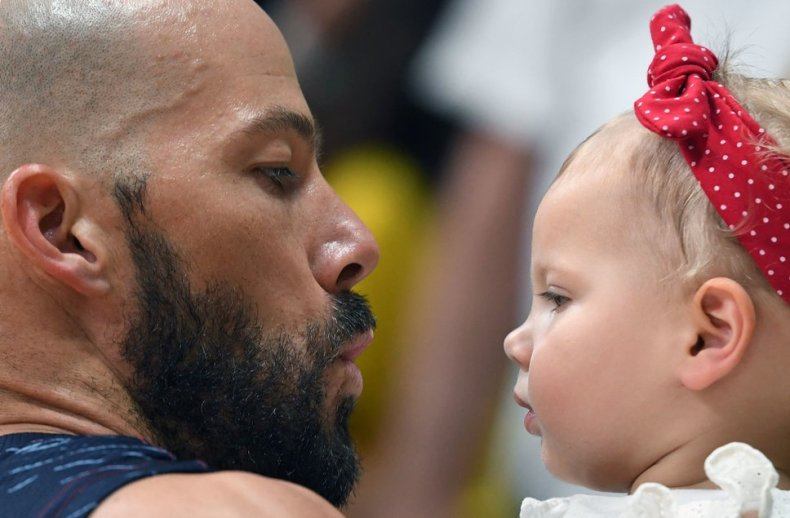 US William Reid Priddy celebrates with his daughter Scarlett after his team's victory over Mexico in the men's qualifying volleyball match at the Maracanazinho stadium in Rio de Janeiro on August 15, 2016, during the Rio 2016 Olympic Games. / AFP / Kirill KUDRYAVTSEV        (Photo credit should read KIRILL KUDRYAVTSEV/AFP/Getty Images)