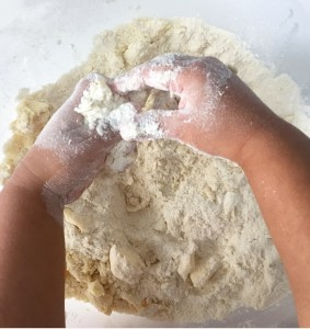 Mixing butter sugar and flour for heart shaped biscuits