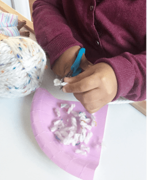 Crafting rice grains by cutting wool into small pieces.