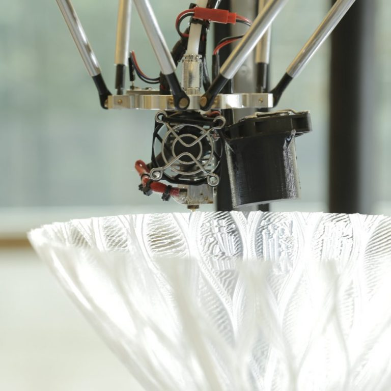 Close-Up on the Delta Tower 3D Printer and the component being printed with Chinese Characters