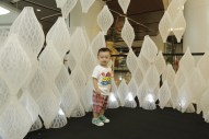 Kid posing in the 3D Printing Pop-Up Studio spiral at the Xintiandi Mall, Shanghai