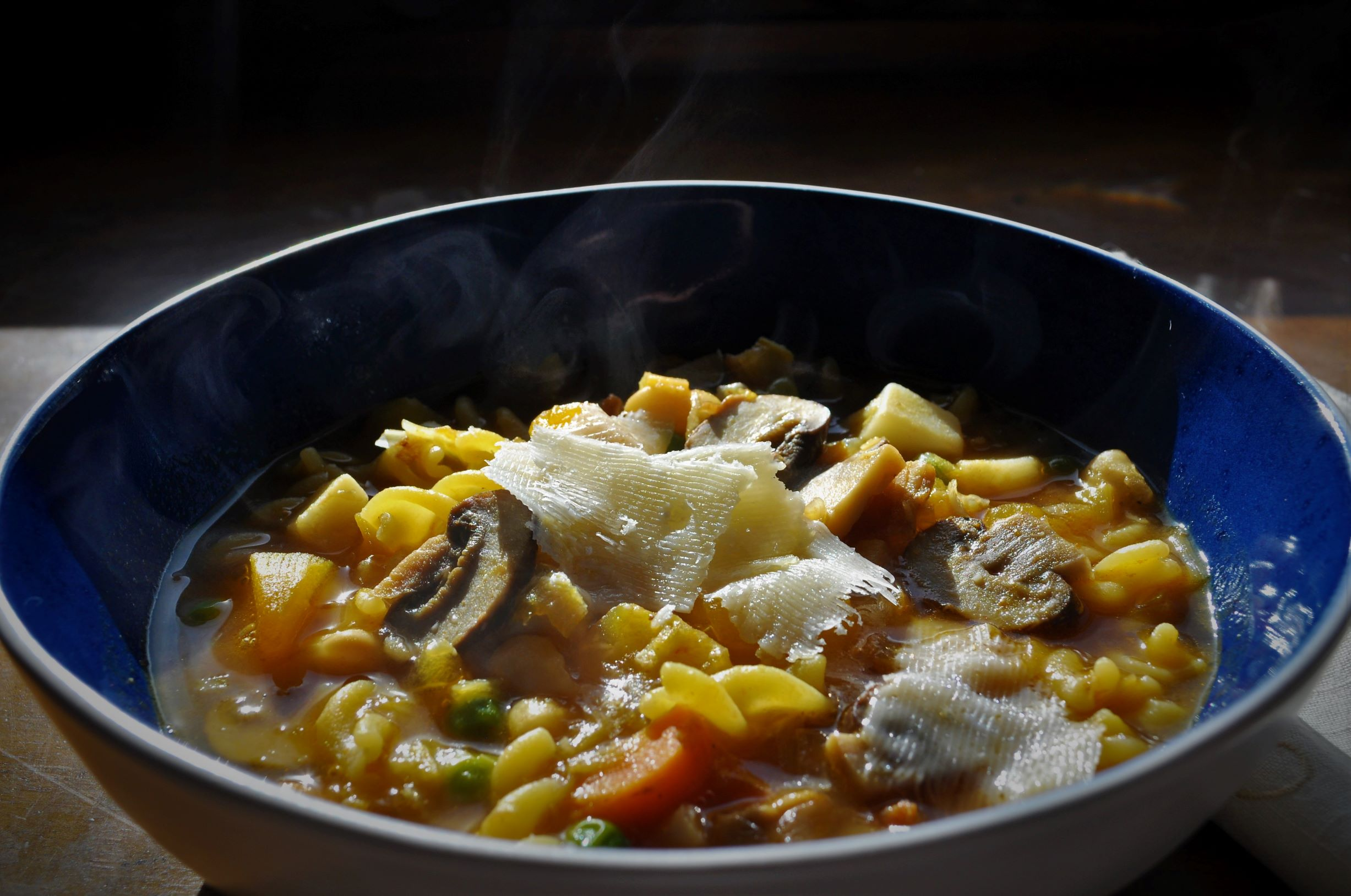 Minestrone soup with pumpkin and mushrooms