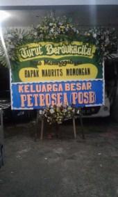 Bunga Papan duka cita di Manado