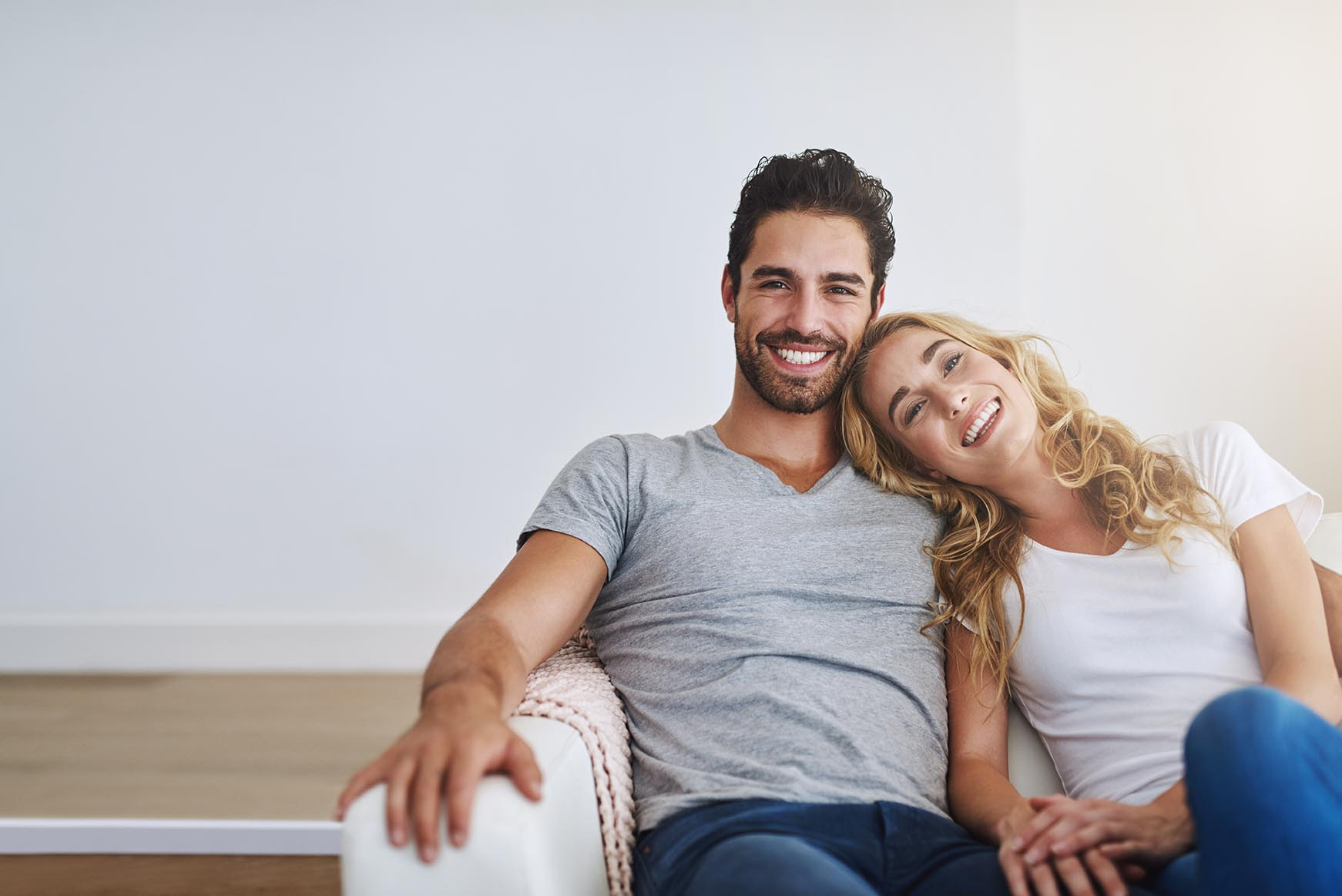 Shot of a young couple relaxing at home