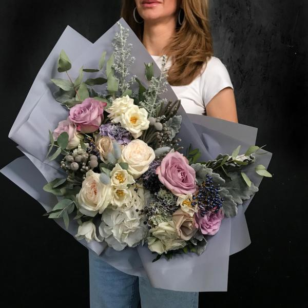 A silver flower composition created with a mix of Hydrangea, premium Roses, Dianthus, Blackberry and Lagurus, white Tulips, Brunia and Dusty Miller.