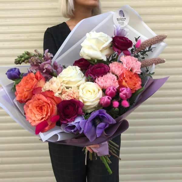 This bouquet is created with of mix of Premium Roses in a variety of colors, Dianthus and Ranunculus, Tulips and Anemones, Matheola and Lagurus. Enjoy!