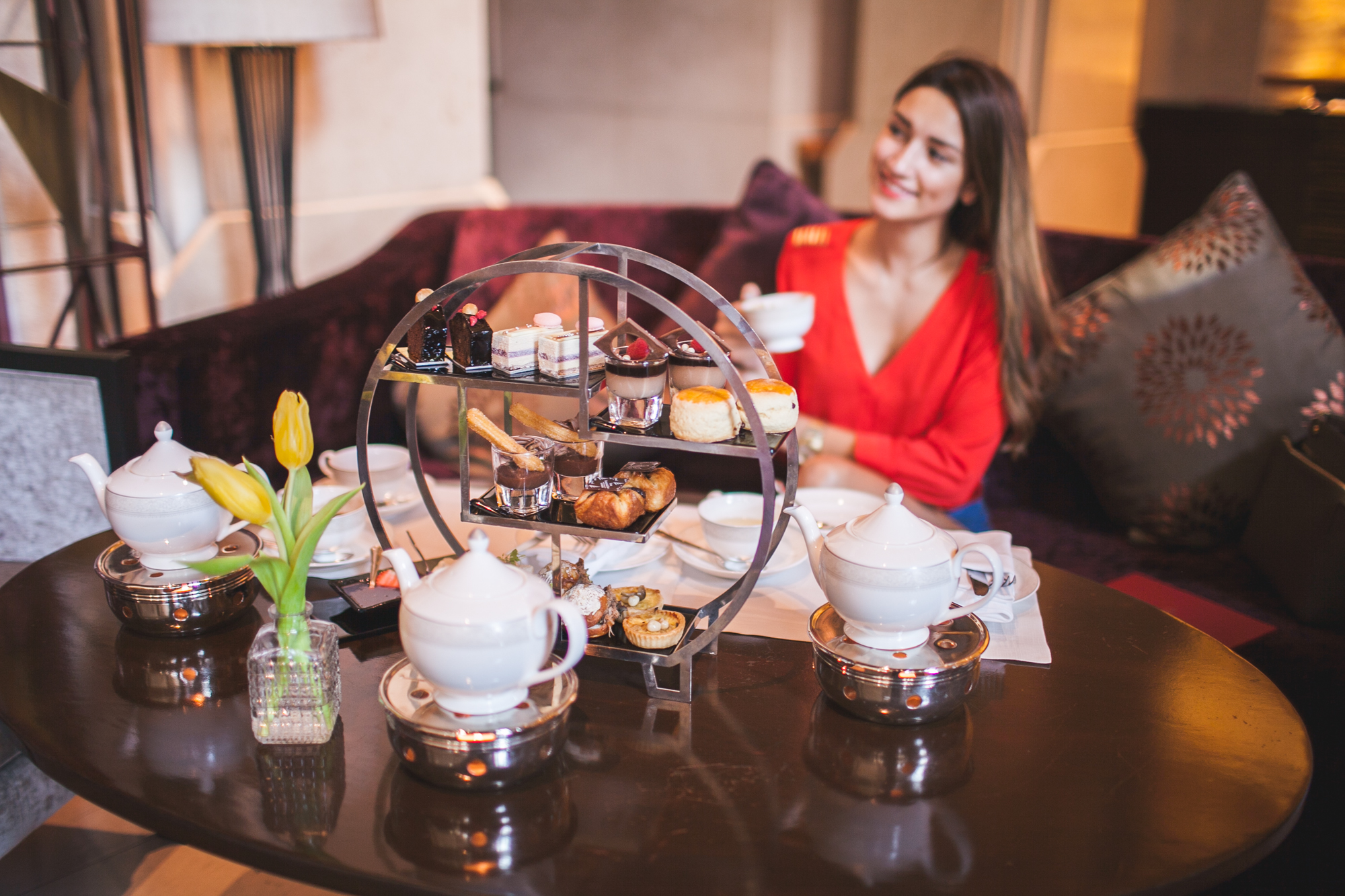 girl having afternoon tea in bangkok at siam kempinski