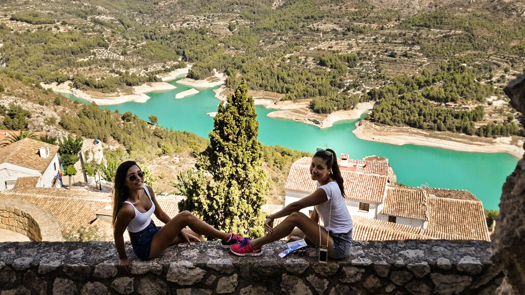to girls sitting in guadalest on summer holiday
