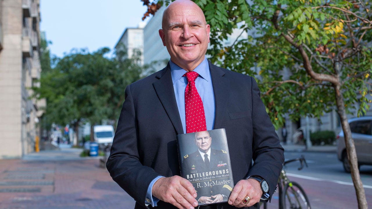 H.R. McMaster holding his book, Battlegrounds.