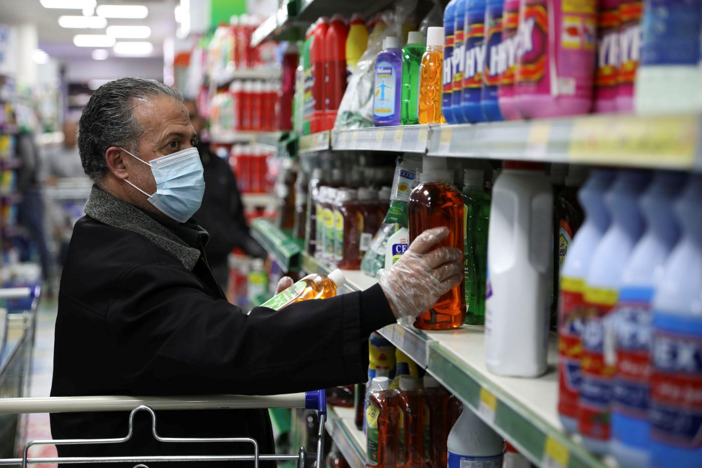 Man shopping in mask in supermarket in Jordan.