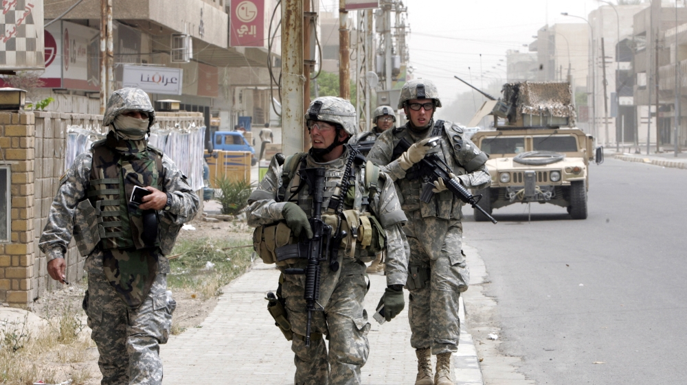 Soldiers walking down the street.