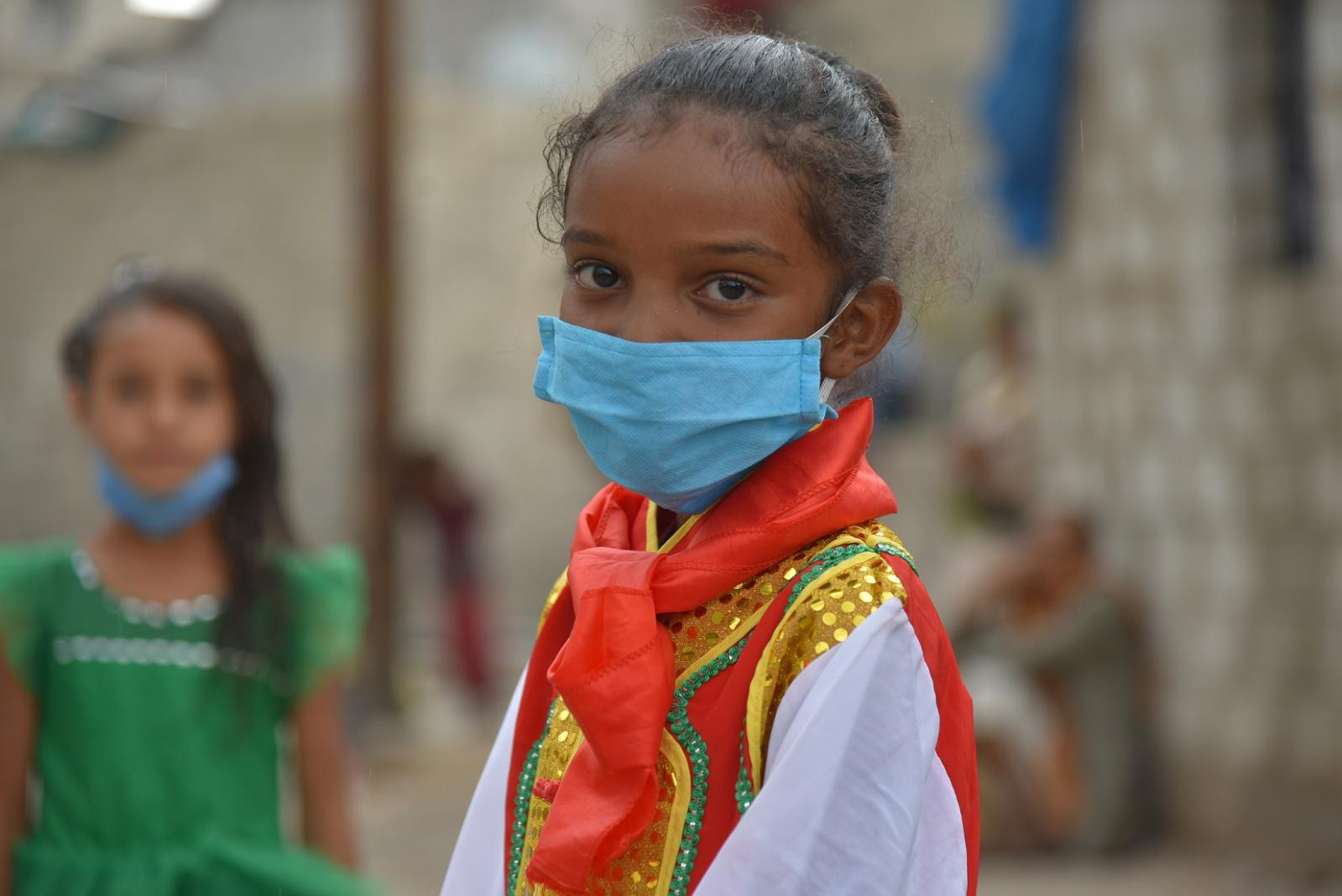 Yemeni young girl in mask.