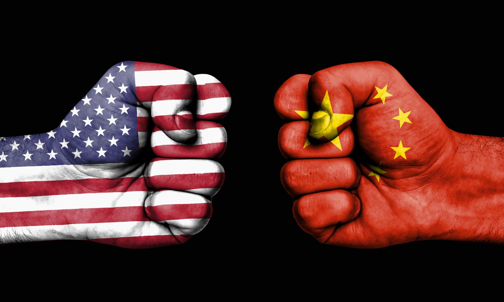 Two firsts displayed across from each other with U.S. and Chinese flags laid over them.