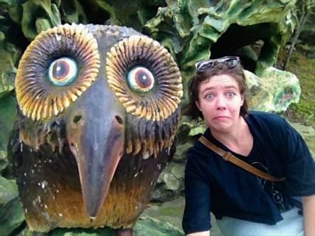 Making faces with strange statues at Haw Par Villa