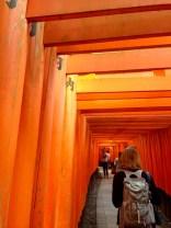 Annin walks through the Torii at Fushimi Inari