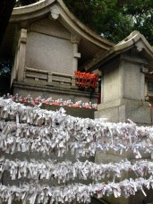 """At temples and shrines you can get """"omikuji"""" or fortunes. If you get a bad fortune you tie the paper near the shrine and it will be purified to remove your bad luck. But my fortune was a really good one, so I got to keep it."""