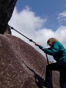 Annin gives climbing the rock a go