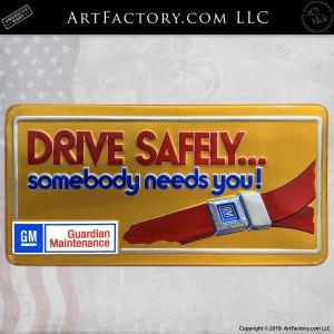 Vintage GM Drive Safely Seatbelt Embossed Tin Sign