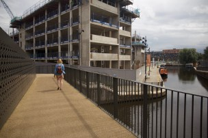 Walking along the bridge towards New Islington Marina