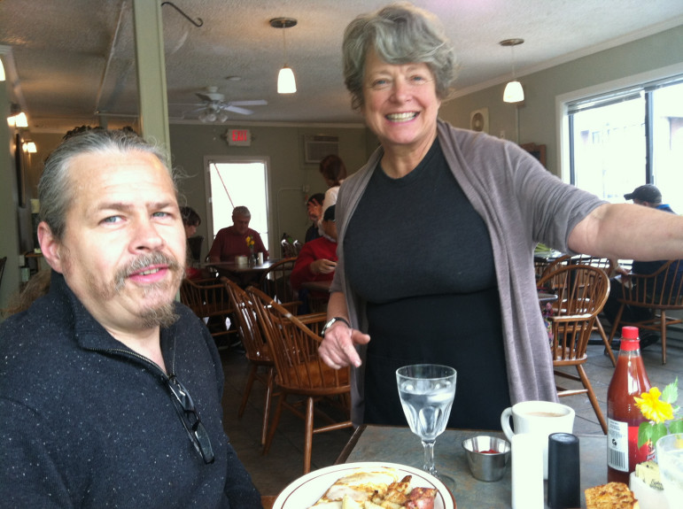 Jane Beaulieu, right, checks in on my hubby, Jim Robidoux, on opening day at The Beanstalk Cafe.