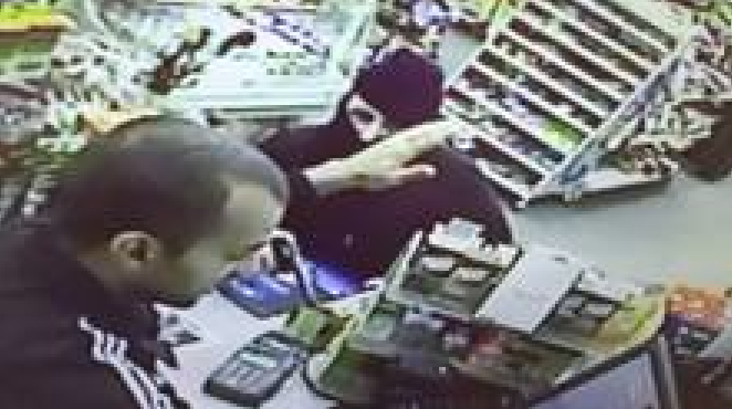 Store surveillance image of man wanted in armed robbery.