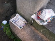An old newspaper and some trash.